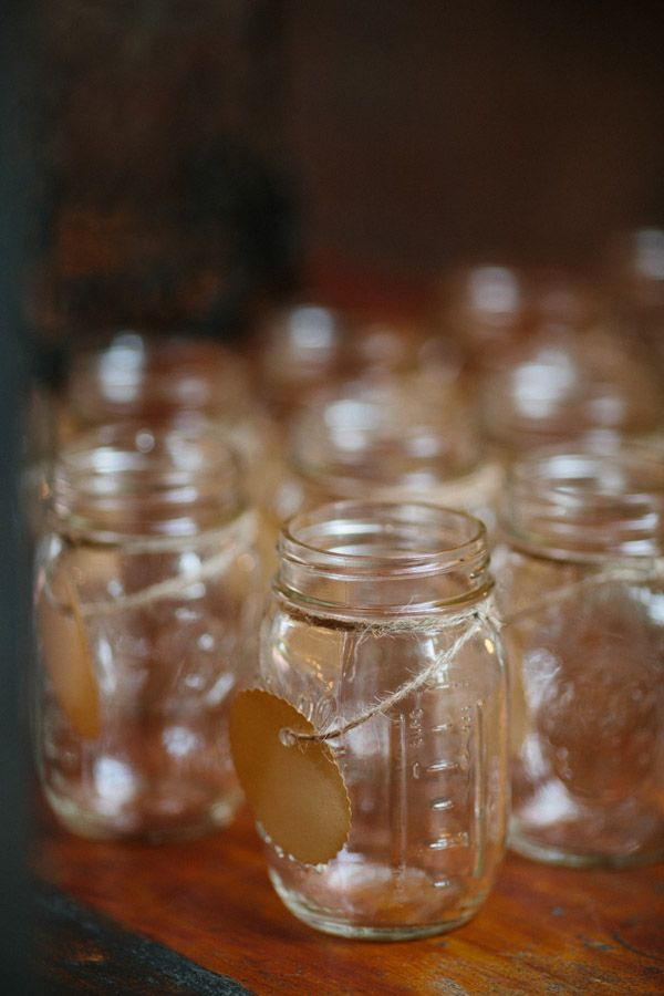 mason jars with name and table number as escort cards and wedding favors #diy #weddingfavors #weddingchicks http://www.weddingchicks.com/2014/01/30/time-travel-wedding/