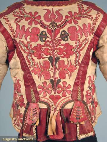 "Hungarian ""kodmen"" Jacket, from Komitat Bekes, short, fitted w/ long sleeves, white leather w/ shearling lining, red leather cuffs & front placket, multi-color wool pom-pom buttons, red, black & yellow stylized leather appliques, 19th c"
