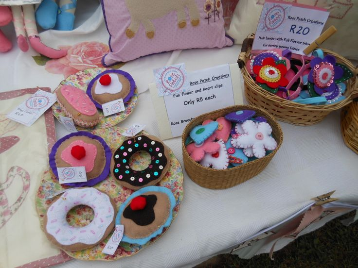 Our Felt fantasy cup cakes, do-nuts and eclairs.  Clips and hairbands.  Lots of little goodies in baskets