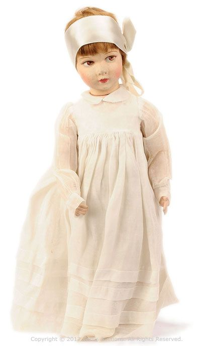 """Raynal Cloth Doll, French, 1920'S/30'S, Felt Moulded Face - Raynal cloth Doll, French, 1920's/30's, felt moulded face, brown side glancing painted eyes and features, brunette mohair wig, fully jointed cotton cloth body, wearing white muslin dress and cotton undergarments, sateen ribbon to head, some wear to muslin dress otherwise Excellent to Excellent Plus, 20""""/51cm."""