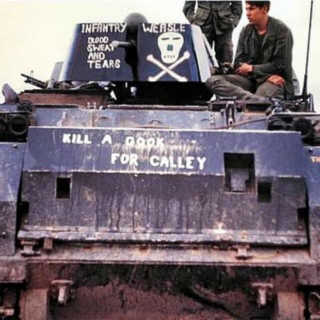 """An M113 Armored Personnel Carrier with graffiti written on it. The """"kill a gook for Calley"""" phrase written on the front is a reference to U.S. Army Second Lieutenant William Calley, the officer found guilty of murdering 22 unarmed South Vietnamese civilians in the My Lai massacre on March 16, 1968."""