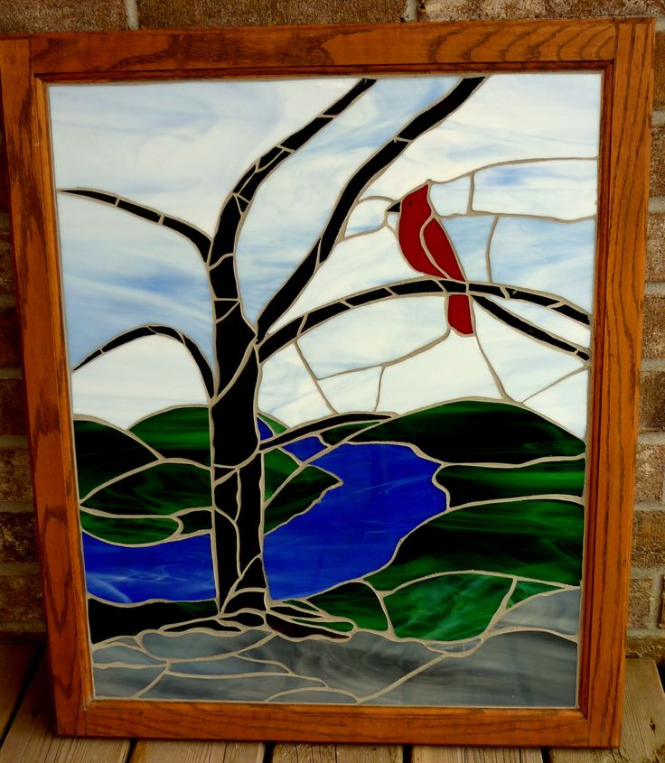 Mosaic cardinal in glass.  This is a project that one of my students abandoned.  The sky, bird, some green hills, and some of the water were cut, but not the tree, or rocks.  Some of the pieces didn't even fit very well together, so it needed some love, and grout.