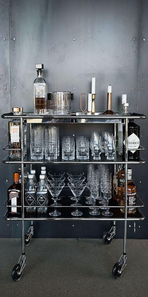 Stunning and masculine styled silver bar cart, fully stocked and organized with liquor, candles, mixers, and glassware, perfect for east entertaining on the fly.