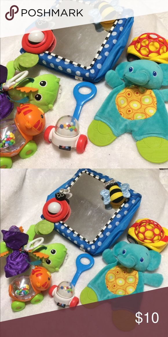 Baby toy bundle Perfect first toys for baby ✨ Sassy mirror, Fisher Price lion and walker rattles, Lamaze vibrating dragon, Bright Starts crinkle elephant, and Ball car with rattling wheels. All but the mirror is in excellent condition, mirror has scratches from general use. Bundle to save! Other