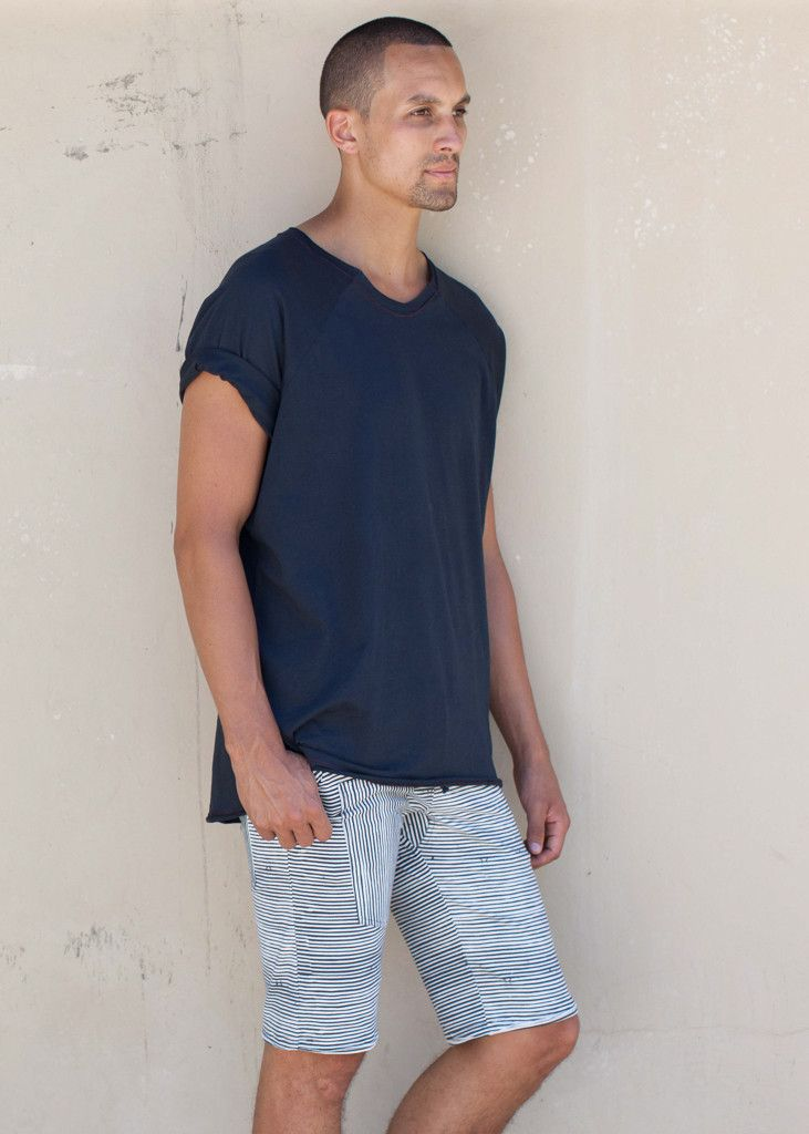 Mens Organic Cotton tee, loose fit with contrast stitching. 100% organic cotton.  Mens Active wear at it's best: ethically made withsubtle detailing. Designed by Ethical Fashion and Yoga wear brand WE-AR, made in Bali with love. Shop online: we-ar.com