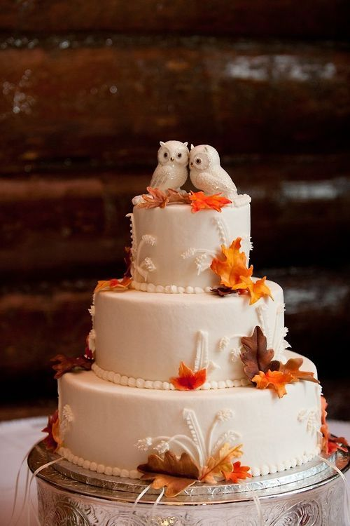 Three-tiered cake with Autumn leaves and owls.