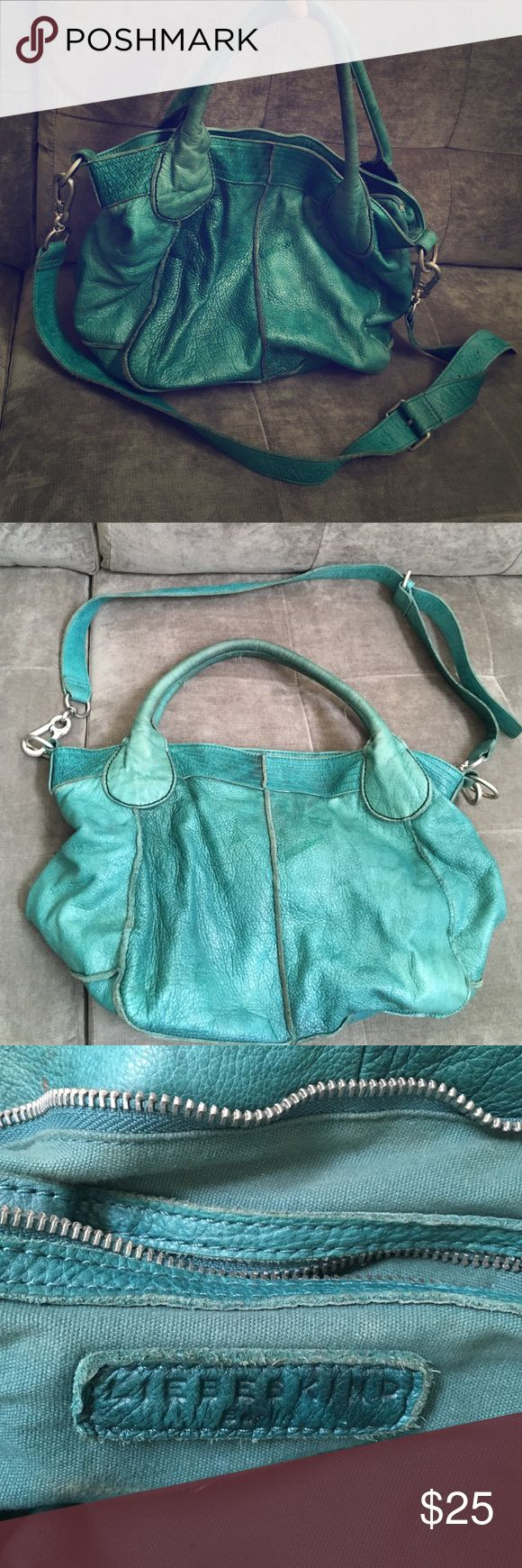 Gorgeous used Liebskind Berlin Leather Purse Have had this for years and loved every minute of it. Authentic Leather. Gorgeous color. Has its normal wear and tear on the inside of the purse. A few spots from a pen and gum. Most of it could be cleaned. Outside is a beautiful blue green color. Starting to fade from being in the sun. Soft leather handles as well as a detachable shoulder strap. Liebeskind Bags Hobos