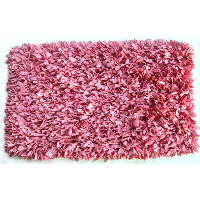 Handmade of jersey cotton material, this rug is a fun, unique addition to any decor. Constructed of 100-percent cotton, this rug showcases shades of pastel pink.