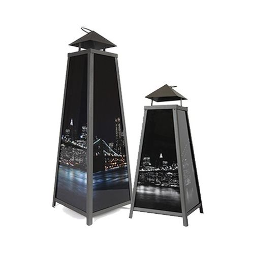 Metal pyramid-shaped lantern with a handle. It has an openable flat to access and exchange candles. Thick glass walls are decorated with a UV print.
