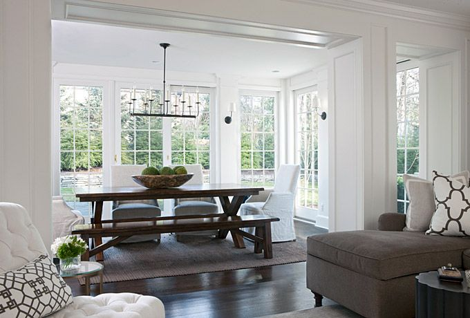 Comfort is key in this casual dining area, featuring a farmhouse table, bench and slipcovered chairs. Carefully selected accessories and lighting complete the sophisticated aesthetic and put a twist on its traditional style. Marianne Jones LLC Marianne Jones - Birmingham, MI
