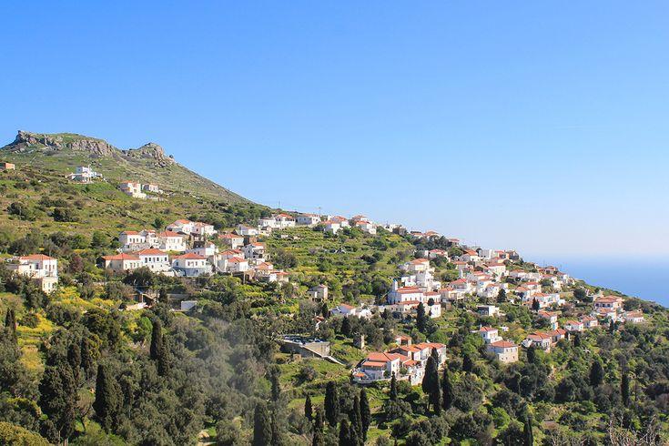 Whitewashed houses tumble down the hillside.