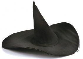 """Wicked Witch of the West"" hat worn by Margaret Hamilton in ""The Wizard of Oz"" (MGM, 1939). Used throughout the film, most prominently in the final ""I'm melting!"" scene, the Adrian-designed hat is constructed of black fabric with a wide, irregularly sided brim supported by a steel frame. It comes with a still photo from the film showing Hamilton wearing the hat. Cone headpiece height: 14""; brim widths (from crown): 5 1/2"" front, 8"" back, 5"" left, 5 1/2"" right."