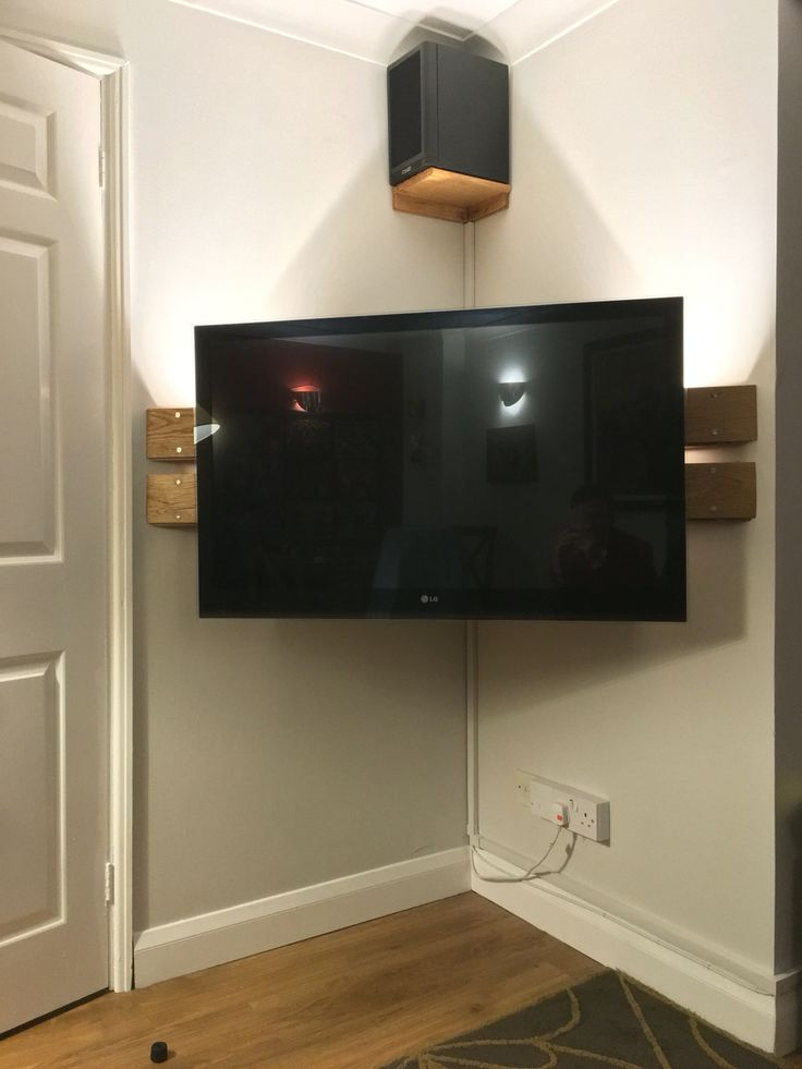 Wall mounted corner TV Stand. DIY. Left over floor boards.