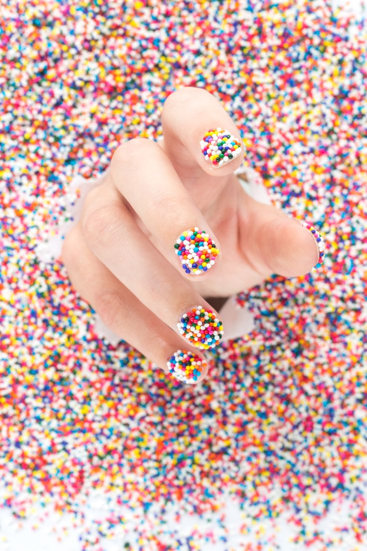 DIY Sprinkle Nails<< this wouldn't work on me, I'd just eat the sprinkles right off my hand