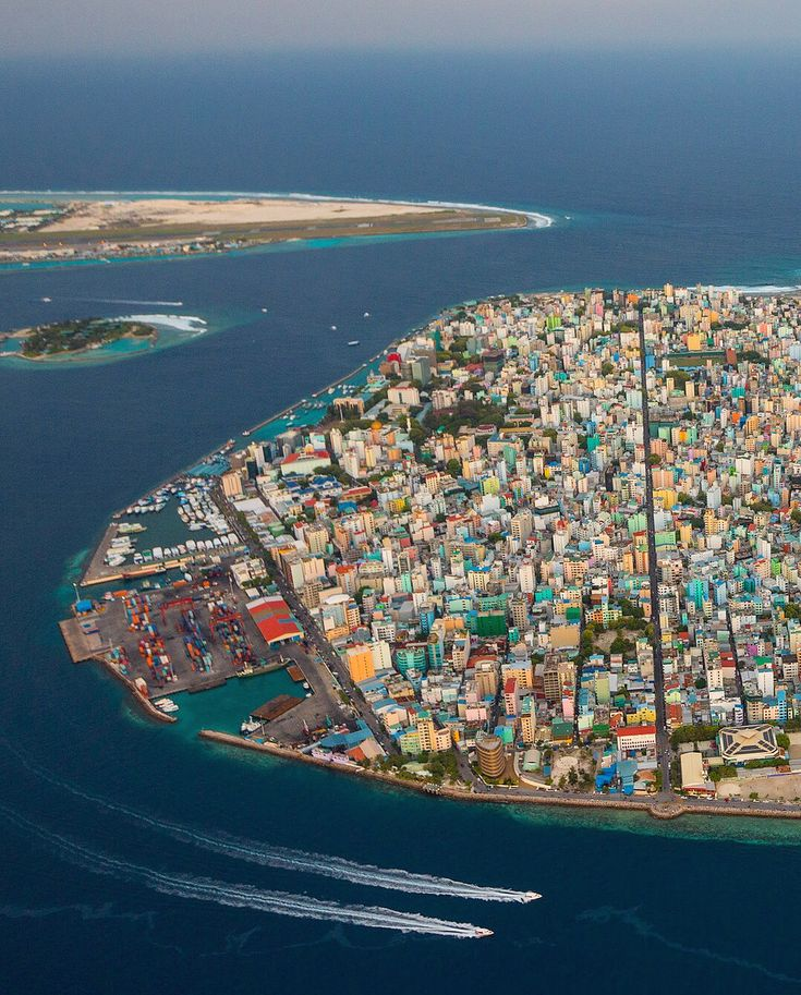 Photograph by George Steinmetz @geosteinmetz  Male rises like a mini-Manhattan in the middle of the Indian Ocean. The capital of the Maldives has over 160,000 people living on an atoll of only 2 sq. km. that is little more than a meter above high water line.  Although the waterfront has been fortified against waves, the corals underneath it are dead and unable to grow upwards, thus dooming the island nation to rising sea level.  For comparison to a healthy reef in the Maldives, go to…