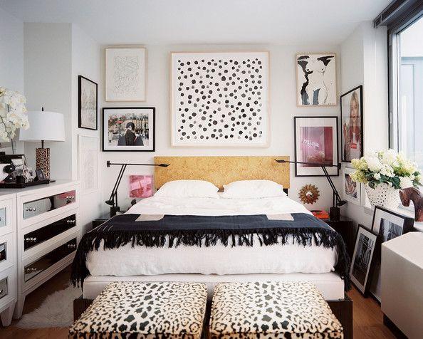 Bedroom - A wall of framed art hung above a burlwood headboard