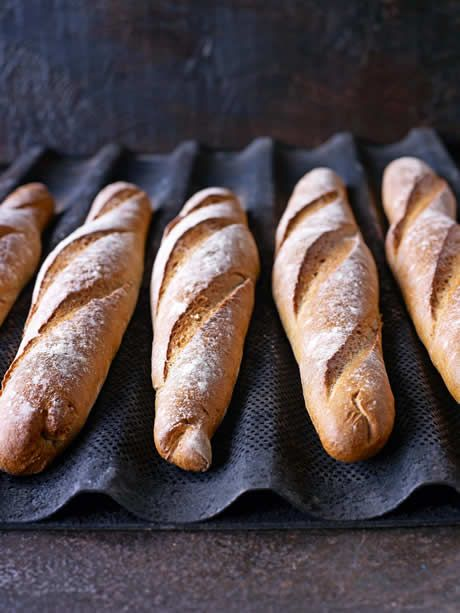 Baguettes   275g strong white bread flour, plus extra for dusting - 6g salt - 6g instant yeast - 185ml cool water - Olive oil for kneading