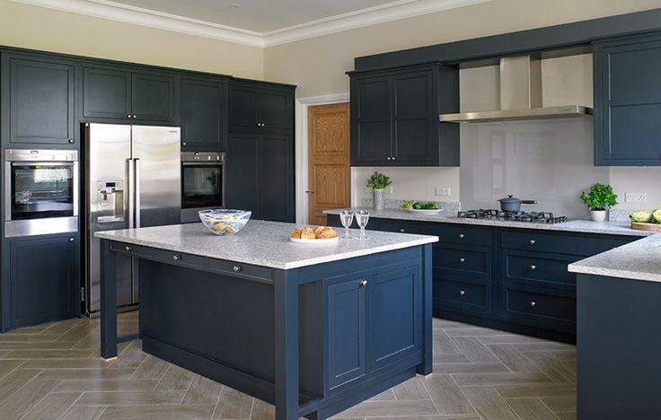 Dark bold navy kitchen with island and built-in appliances, Esher Surrey