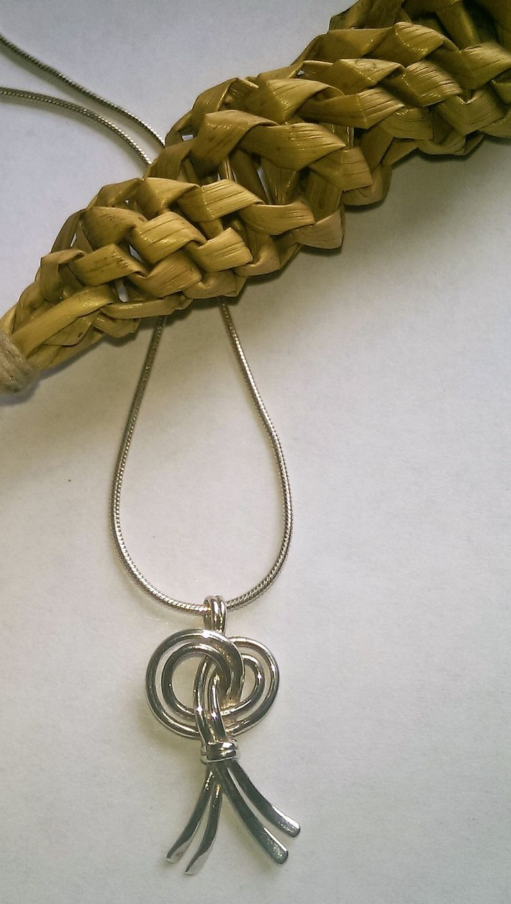 Silver Harvest Knot pendant... set on a  version in straw.  Several examples on show in Decorative Arts and History, Dublin , and also Courntry Life, in Turlough Park.