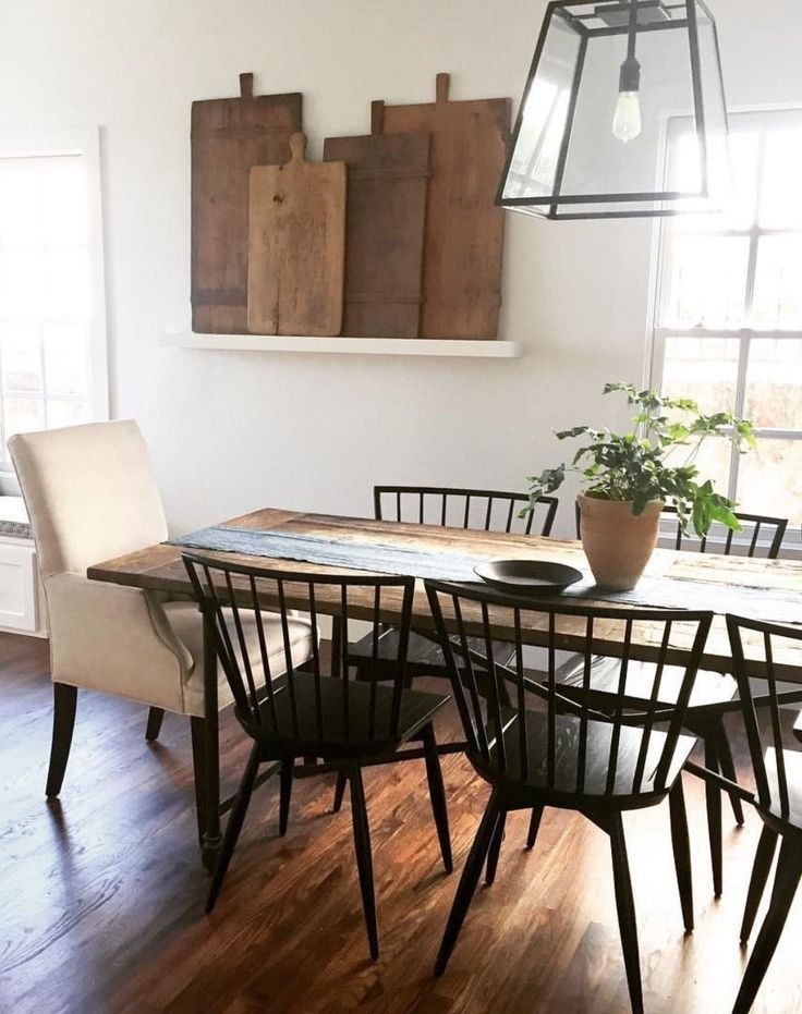 Simple Farmhouse Dining Room With Black Chairs And Rustic Wood Table