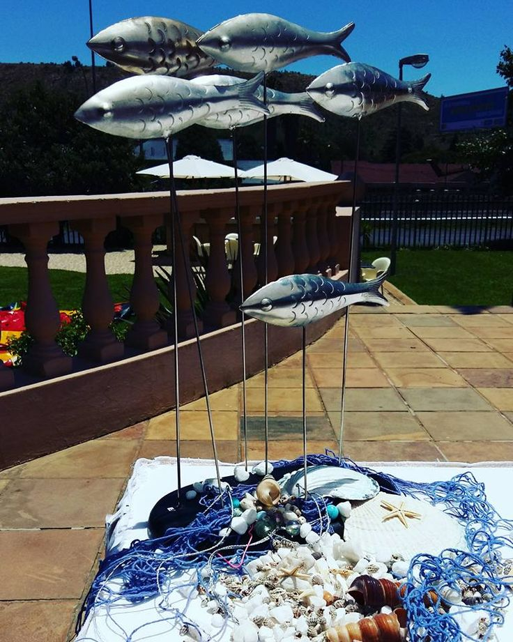 Decorations and decor with shells and fish, and fish net for a nautical theme.