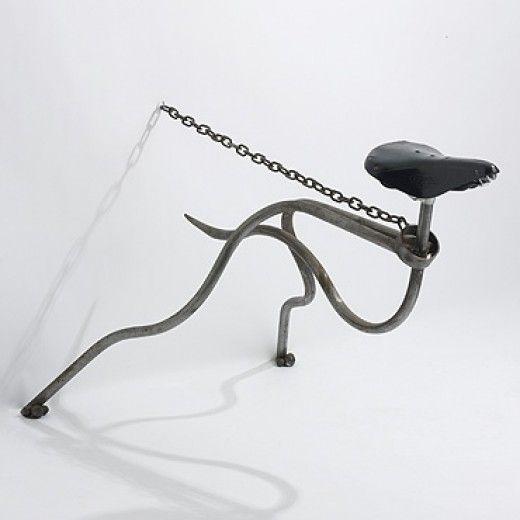 "Mark Lewis    ""Greyhound Chair""  . United Kingdom, c. 1985.  Tubular steel, steel chain, bicycle seat.    40 w x 28 d x 28 h inches"