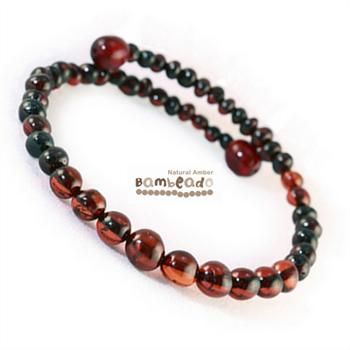 This bracelet is made from round baltic amber in a Dark Cherry colour. The bracelet is made from memory wire that retains it's shape when coiled around your wrist (a little like a slinky!). There is no need to fiddle with a clasp.While Bambeado amber comes in several colours, the colour is just a matter of personal choice. The colours may vary slightly from the images on the website due to variations in the amber beads. Each amber bracelet is unique.