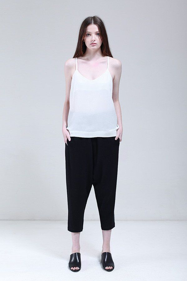 From Nique's Summer 16/17 SYNAESTHESIA Collection. - Drop crotch pant with tapered leg- Elastic side panels on waistband - Front fly opening and front in-seam pockets See our Manager, Maddy wear the Spectrum pantshttps://www.nique.com.au/blogs/nique-journal/staff-picks-maddy Fabric: 40% Linen 60% Rayon Fit: Model is 175cm tall and wears a size 10 AU
