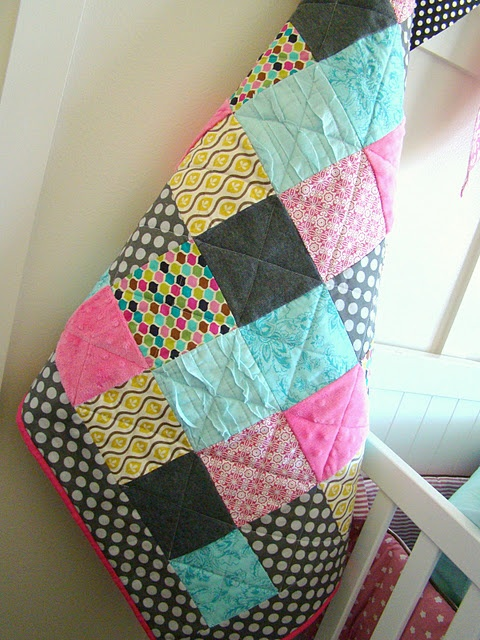 love the gray polka dot border on this one & I'm completely quilting the two baby quilt tops I made last week like this. thrifty & adorable.