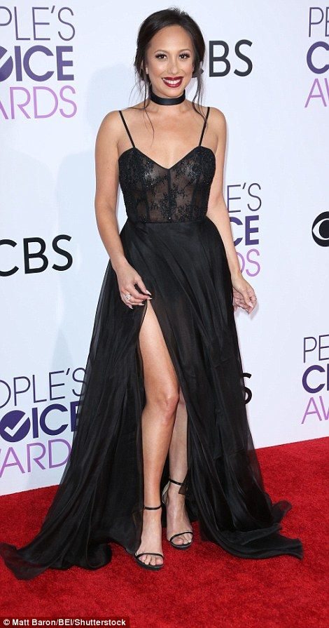 Thigh's the limit: Dancer Cheryl Burke looked super glam in a black gown with slightly sheer skirt
