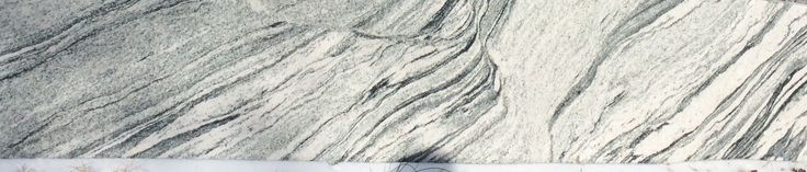 Viscount Blanc Granite, waves of charcoal with black speckled white granite.