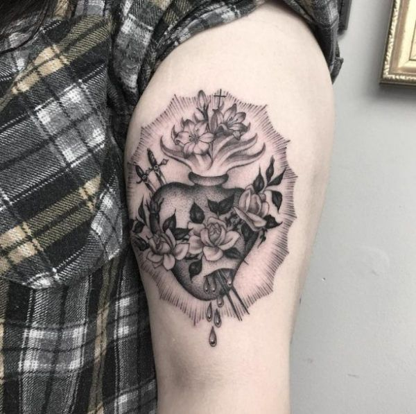 Tattoo stuck heart with flowers  - http://tattootodesign.com/tattoo-stuck-heart-with-flowers/  |  #Tattoo, #Tattooed, #Tattoos