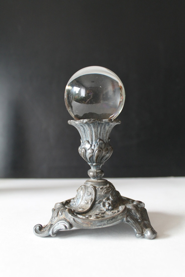 Vintage Crystal Ball on Pewter stand (most likely an antique candle stick, you could use any of your favorite candle sticks as your Ball Stand, Crystal would be nice, mine is an old dragon candle stick, the candle rested in his open mouth, now my crystal ball does!)