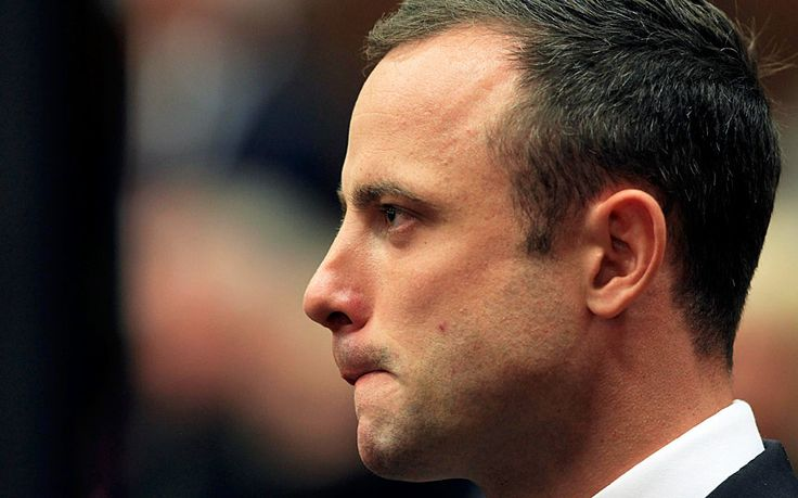 Oscar Pistorius arrives in court ahead of his murder trial at the North Gauteng High Court in Pretoria