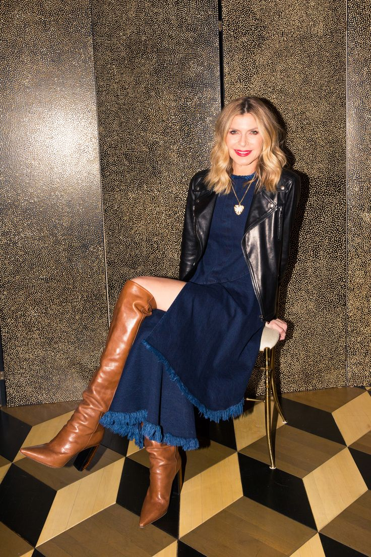 Inside Finery Founder Whitney Casey's Closet: When someone has as much energy and personality as Casey does, they usually have a wardrobe to match, which was exactly the case when we finally dug into the goods in her bedroom-sized-by-NYC-standards closet. -- Denim dress and thigh high brown boots | coveteur.com
