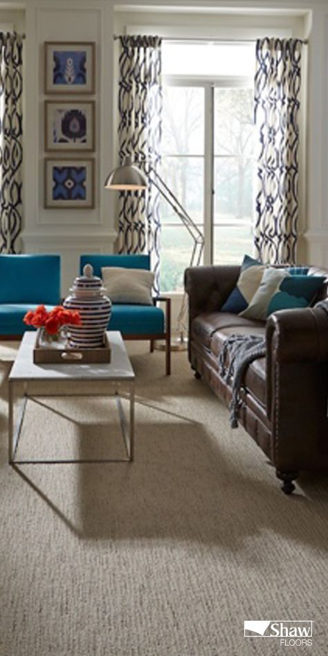 Indian Ocean Teal is another color we love. It's a deeper dive into the water colors that have made such a splash in today's home décor. (Two water references in one sentence.  Impressive, huh?) Actually, this rich color can serve as a bridge color between the cool, barely-there water colors so prevalent in homes today and the dark tones of always-classic navy. Notice how this rich color combines beautifully with navy in this lovely living room.