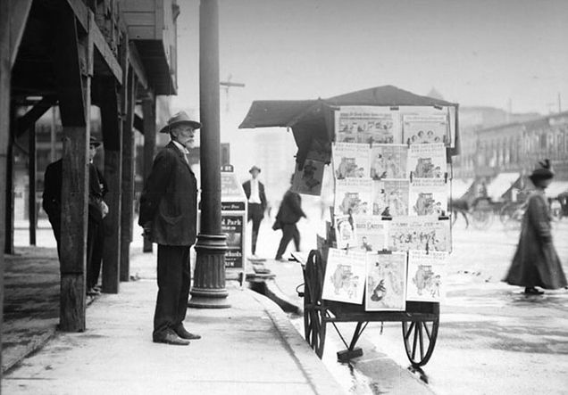 A man stands next to a news stand in Salt Lake City, circa 1901. Courtesy Utah State Historical Society