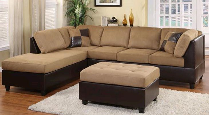 Sectional sofa with ottoman. Love the combination of plush material and leather. Don't love the pillows. Ew.