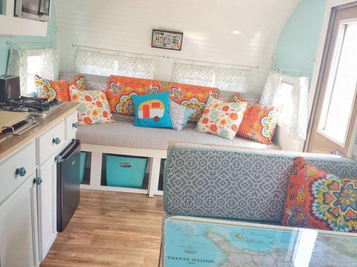 bright vintage camper  I love the open storage under sofa area.  Easy access!  Coordinating totes.  Great color scheme too!