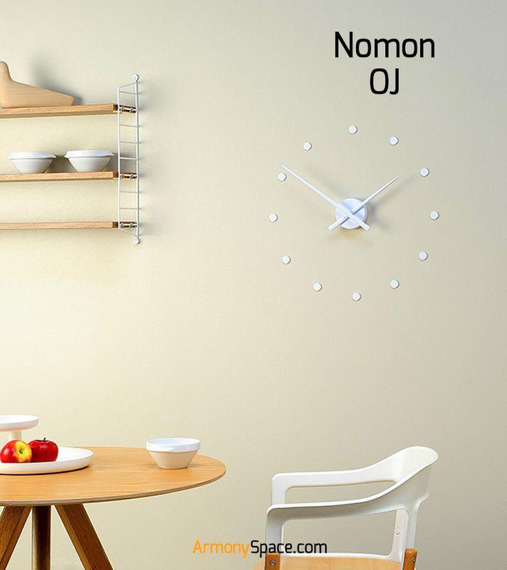 Reloj adhesivo de pared OJ de Nomon · Wall Clock OJ by Nomon. Elaborado en poliestireno disponible en una gran variedad de colores. Señales horarias marcadas con puntos. Posibilidad de personalización con packs de números (4 o 12) en varios colores, medidas y materiales. www.armonyspace.com