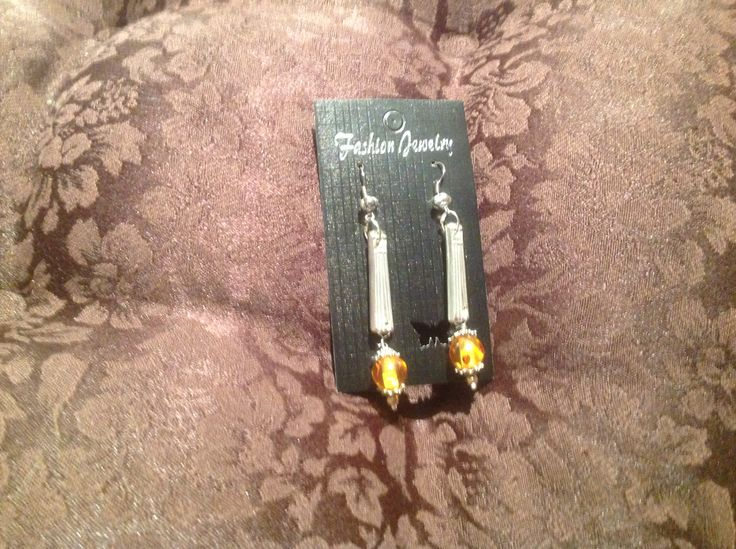 Earrings, made from sections of silver plate fork handles, enhanced with Amber  coloured beads.