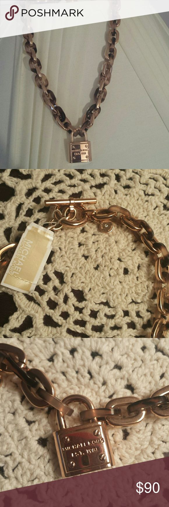 Michael Kors Heritage Padlock Necklace Gorgeous  Michael Kors heritage padlock necklace. Inter locking links alternating between rose gold and tortoise, toggle closure and padlock at the center. Michael Kors Jewelry Necklaces
