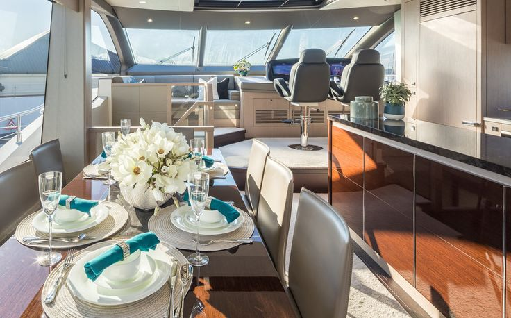 Creating an idyllic space overlooking the beautiful ocean views, we dressed the exquisite dining table on the Sunseeker 76 Yacht with an elegant floral centrepiece.