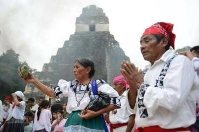 Mayan shamans take part in a ceremony on December 21, 2012, celebrating the end of the Mayan cycle known as Bak'tun 13 and the start of the Maya new age, at the Tikal archaeological site, Peten department, 560 kms north of Guatemala City.Press TV