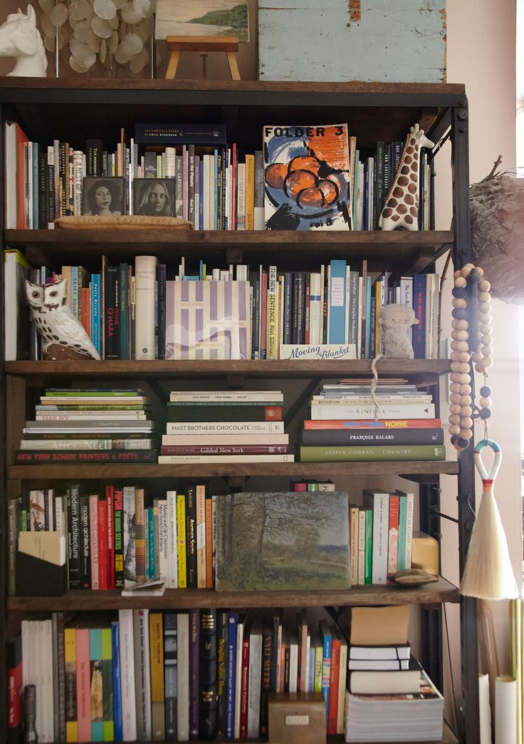 A cool bookshelf with odds and ends