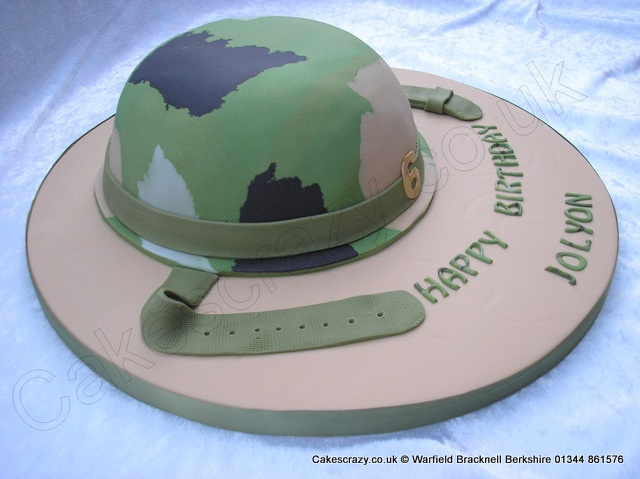 Army helmet shaped cake covered with a mixed camouflage effect and textured straps