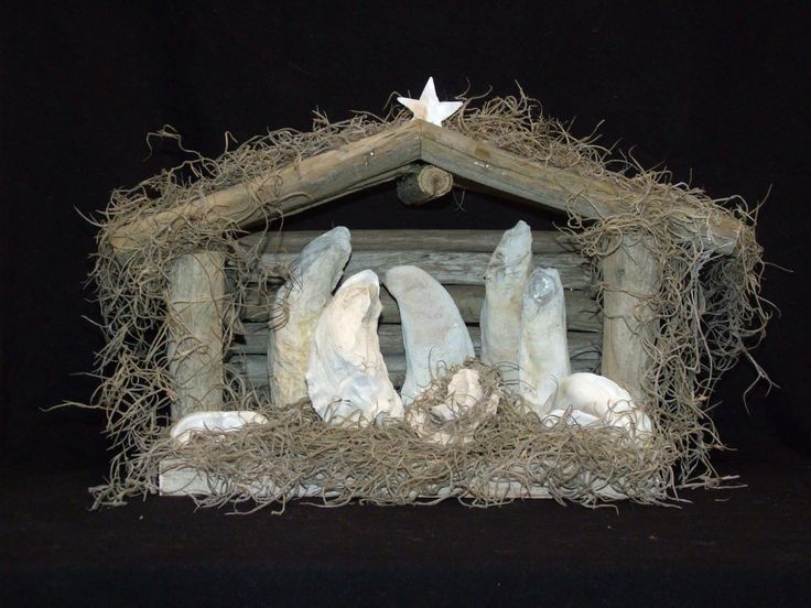 Handmade oyster shell nativity scene made with local oyster shells, driftwood, and moss.  Made by Judi & Bill Judge.