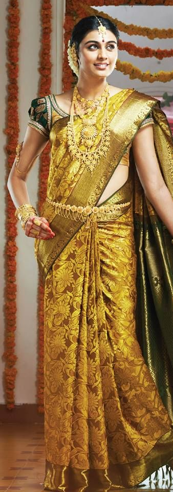 South Indian bride. Temple jewelry. Jhumkis.Gold silk kanchipuram sari.Braid with fresh flowers. Tamil bride. Telugu bride. Kannada bride. Hindu bride. Malayalee bride.Kerala bride.South Indian wedding.