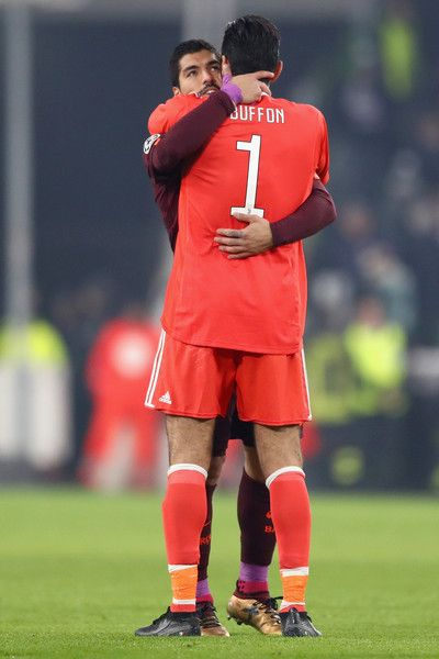 Gianluigi Buffon of Juventus and Luis Suarez of Barcelona congratulate each other after the UEFA Champions League group D match between Juventus and FC Barcelona at Allianz Stadium on November 22, 2017 in Turin, Italy.