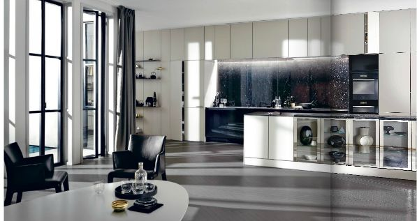 Like comfy seating area with low table.  Like glass fronted cabinets. Like 2 colour scheme. Like impact splashback. Like open shelving (back left) on panels which match cabinetry